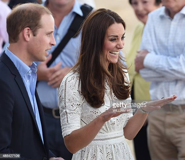 Catherine the Duchess of Cambridge and Prince William speak to people on the beach at Manly on Sydney's north shore on April 18 2014 Britain's Prince...