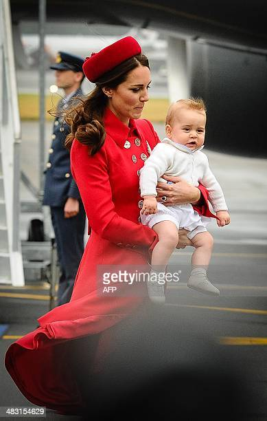 Catherine the Duchess of Cambridge carries baby Prince George upon their arrival at the international airport in Wellington on April 7 2014 Britain's...