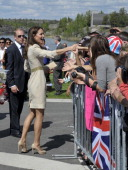 Catherine the Duchess of Cambridge greets the crowd during a visit with her husband Britain's Prince William to the Somba K'e Civic Plaza in...