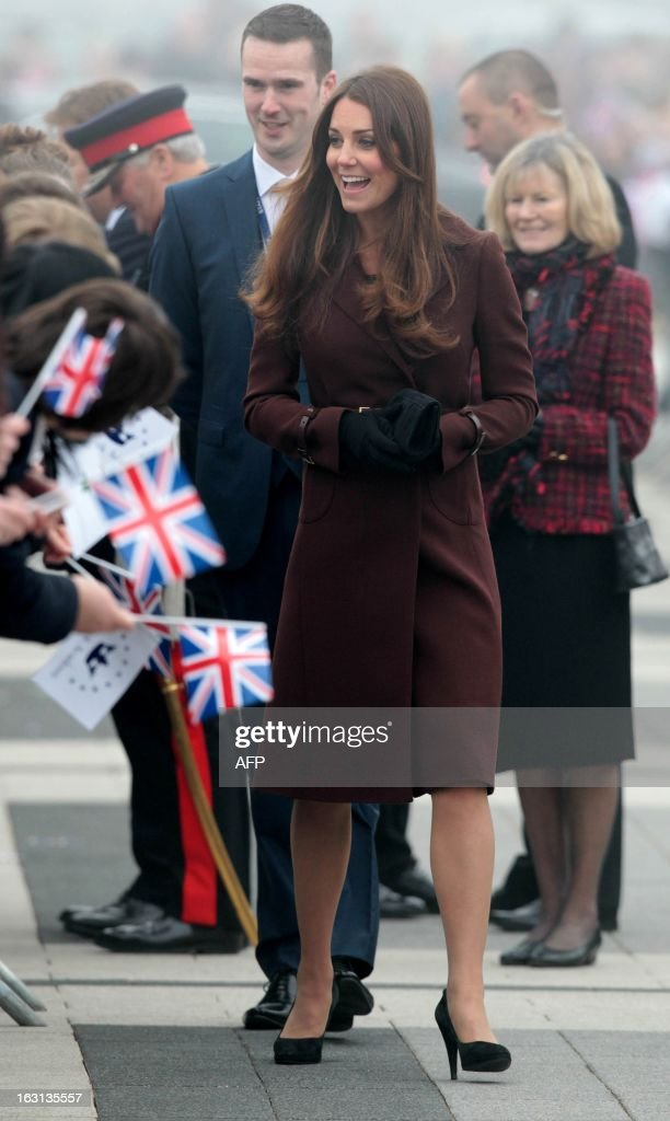 Catherine, the Duchess of Cambridge is greeted by crowds as she arrives at the Havelock Academy in Grimsby, north east England 5 March 2013. The Duchess of Cambridge is on an official visit to Grimsby during which she visited the National Fishing Heritage Centre and will meet with unemployed teenagers. AFP PHOTO / LINDSEY PARNABY