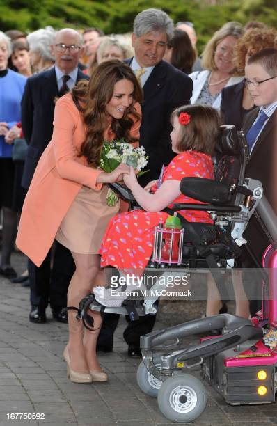 Catherine The Duchess Of Cambridge is presented with flowers by Sally Evans on visit to Naomi House on April 29 2013 in Hampshire England