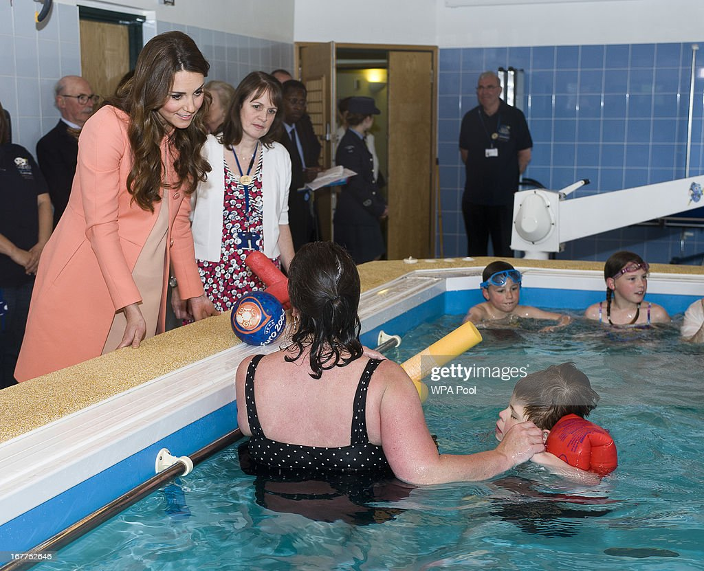 <a gi-track='captionPersonalityLinkClicked' href=/galleries/search?phrase=Catherine+-+Duchess+of+Cambridge&family=editorial&specificpeople=542588 ng-click='$event.stopPropagation()'>Catherine</a>, The Duchess Of Cambridge meets children and staff in the hydrotherapy pool during a visit to Naomi House Children's Hospice on April 29, 2013 near Winchester, Hampshire, England.