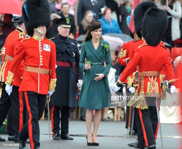 Catherine the Duchess of Cambridge presents shamrocks to members of the 1st Battalion Irish Guards on St Patrick's Day Parade at Mons Barracks in...
