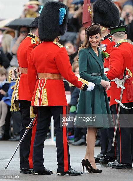 Catherine the Duchess of Cambridge reacts as she visits the 1st Battalion Irish Guards at the St Patrick's Day Parade on March 17 2012 at Mons...