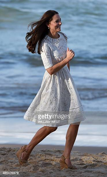 Catherine the Duchess of Cambridge runs along the beach at Manly on Sydney's north shore on April 18 2014 Britain's Prince William his wife Kate and...