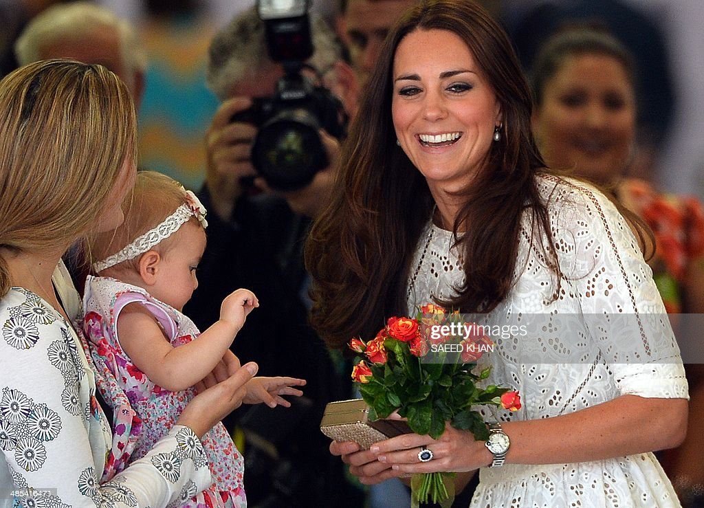 Catherine the Duchess of Cambridge smiles as she receives flowers from a young girl at the Sydney Royal Easter Show in Sydney on April 18 2014...
