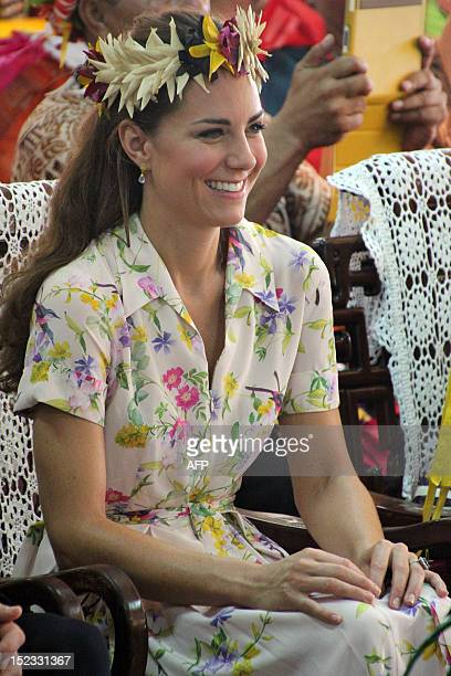 Catherine the Duchess of Cambridge smiles during a ceremony to mark her and her husband's Britain's Prince William farewell from Tuvalu in the Vaiaku...