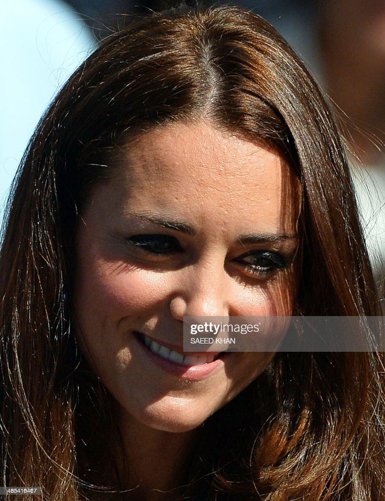 Catherine the Duchess of Cambridge smiles during a visit to the Sydney Royal Easter Show in Sydney on April 18 2014 Britain's Prince William his wife...