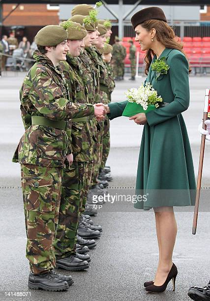Catherine the Duchess of Cambridge talks to members of the Irish guards as she takes part in a St Patrick's Day parade while visiting Aldershot...