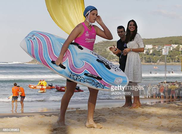 Catherine the Duchess of Cambridge watches as a young surf lifesaving competitor crosses the finish line during her visit to a surf lifesaving...