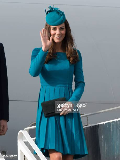 Catherine the Duchess of Cambridge waves as she arrives in Dunedin during a welcome at Dunedin airport in Dunedin on April 13 2014 William Kate and...