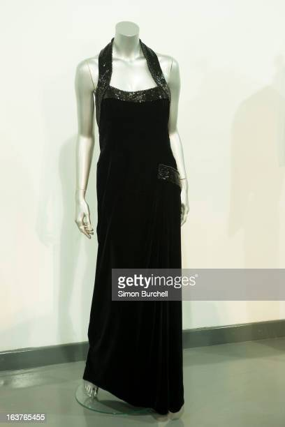Catherine Walker black velvet and beaded evening gown used in a Mario Testino shoot for Vanity Fair at Kensington Palace 1997 is displayed at a...