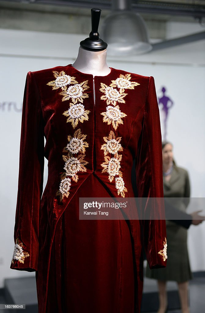 A Catherine Walker burgundy velvet sheath with embroidered tailcoat, worn at the state visit of Korea, 1992 and to the premiere of 'Steel Magnolias' and 1990 is displayed at a photocall ahead of the the 'Fit For a Princess' auction on March 15, 2013 in London, England. 10 dresses from the collection of Diana, Princess of Wales are to be auctioned by specialist Kerry Taylor.