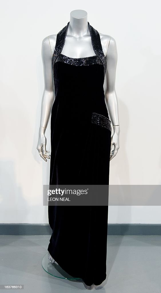 Catherine Walker evening gown worn by Britain's Princess Diana for a Vanity Fair photo-shoot with Mario Testino in 1997 is displayed at Kerry Taylor Auction house in south London on March 15, 2013 ahead of a sale of ten dresses that belonged to the Princess. The gown is expected to sell for between 50,000 - 70,000 GBP (76,000 - 106,000 USD) at the auction taking place on March 19, 2013.
