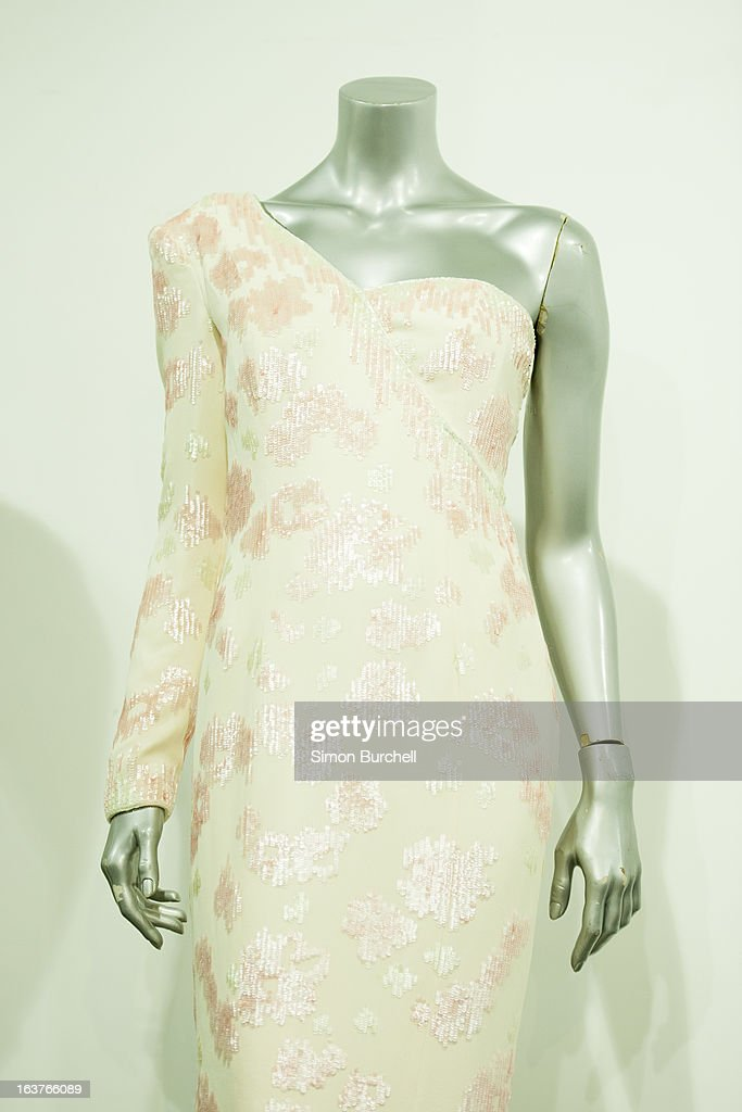 A Catherine Walker pink sequinned ivory crepe gown with asymmetric neckline, worn at the banquet given by President Collor on a state visit to Brazil and 1991 is displayed at a photocall ahead of the the 'Fit For a Princess' auction on March 15, 2013 in London, England. 10 dresses from the collection of Diana, Princess of Wales are to be auctioned by specialist Kerry Taylor.