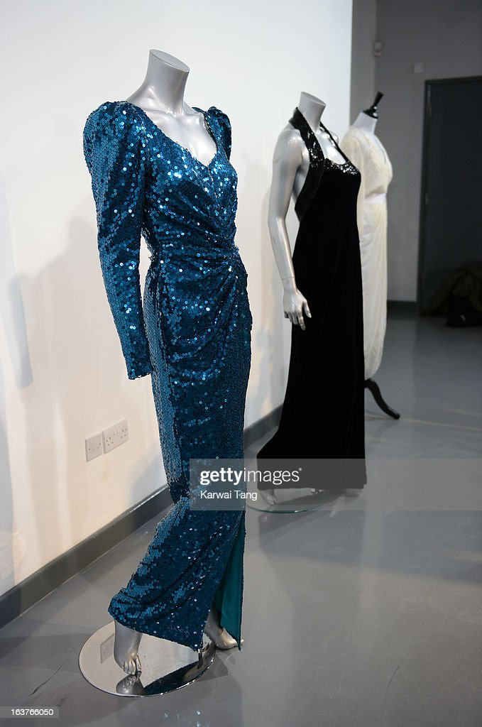 A Catherine Walker sea-green sequinned evening gown, worn for the state visit to Austria in 1989, labelled 'The Chelsea Design Co Ltd, London' and of Jacob Schlaeper sequinned satin is displayed at a photocall ahead of the the 'Fit For a Princess' auction on March 15, 2013 in London, England. 10 dresses from the collection of Diana, Princess of Wales are to be auctioned by specialist Kerry Taylor.