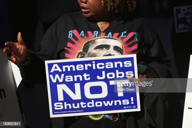 Catherine Wriddley carries a sign during a protest and prayer vigil held to call for an end to the federal government shutdown on October 8 2013 in...