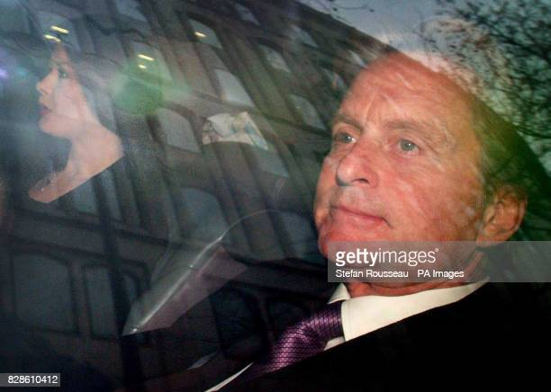 Catherine Zeta Jones and her husband Michael Douglas arriving at the High Court in London where they are due to give evidence in their claim for...