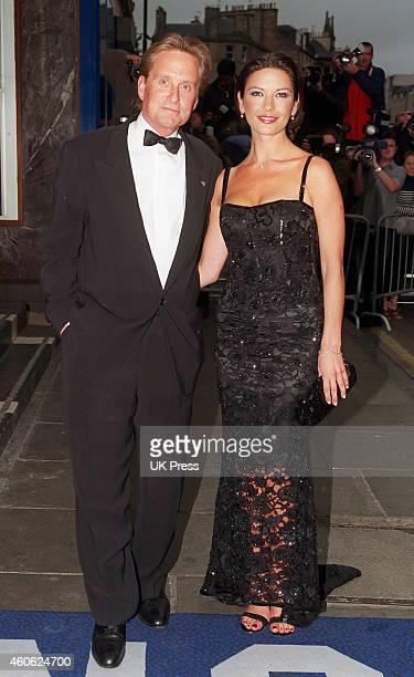 Catherine Zeta Jones and Michael Douglas attend The Premiere of Entrapment in Edinburgh on June 30 1999 in Edinburgh Scotland
