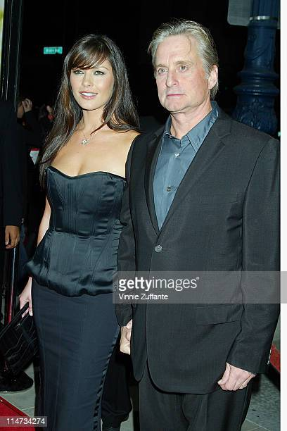 Catherine Zeta Jones and Michael Douglas attending the premiere of 'Intolerable Cruelty' at the Academy Theatre in Los Angeles California 09/30/03