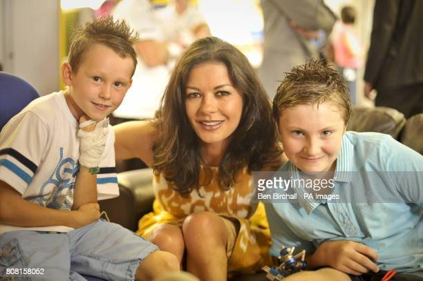 Catherine Zeta Jones with Sean Kelly aged nine and Liam Barker aged 13 both from Cardiff in the children's play room during a visit to the Children's...