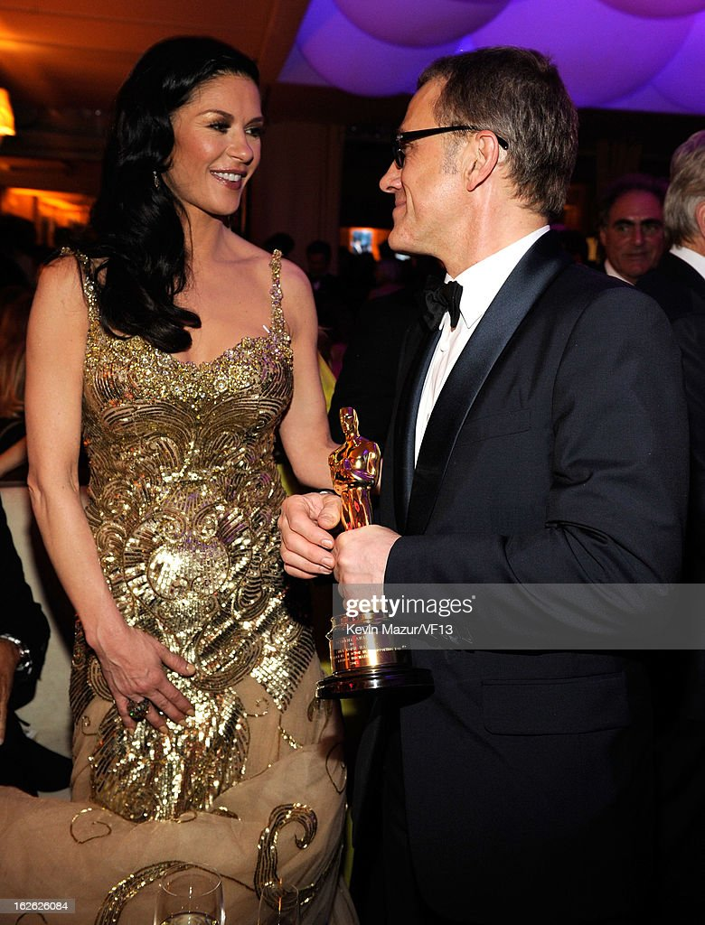 Catherine Zeta-Jones and Christophe Waltz attend the 2013 Vanity Fair Oscar Party hosted by Graydon Carter at Sunset Tower on February 24, 2013 in West Hollywood, California.