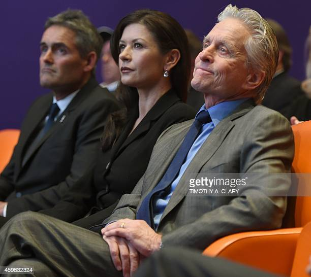Catherine ZetaJones and Michael Douglas attend a press conference in New York December 2 2014 to announce the site of the 35th America's Cup...