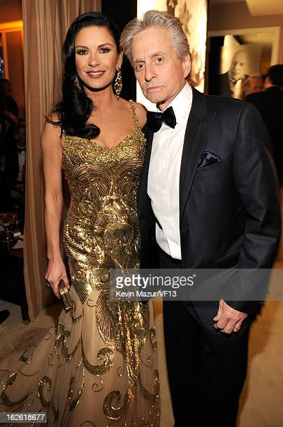 Catherine ZetaJones and Michael Douglas attend the 2013 Vanity Fair Oscar Party hosted by Graydon Carter at Sunset Tower on February 24 2013 in West...