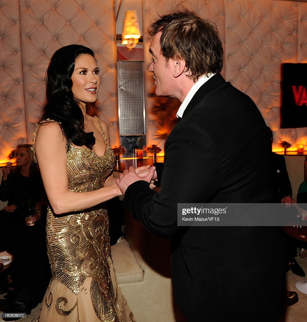 Catherine Zeta-Jones and Quentin Tarantino attends the 2013 Vanity Fair Oscar Party hosted by Graydon Carter at Sunset Tower on February 24, 2013 in West Hollywood, California.