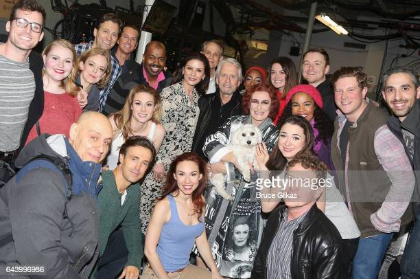 Catherine ZetaJones Glenn Close and Michael Douglas pose with the cast backstage at the hit musical 'Sunset Boulevard' on Broadway at The Palace...