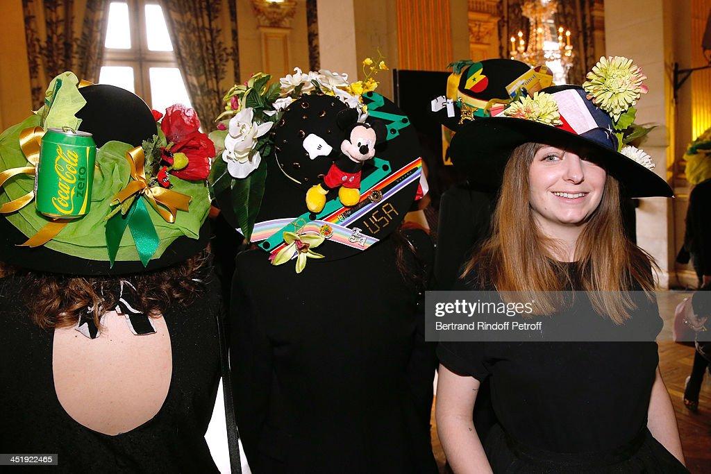 Catherinettes from Yves Saint Laurent attend Sainte-Catherine Celebration at Mairie de Paris on November 25, 2013 in Paris, France.