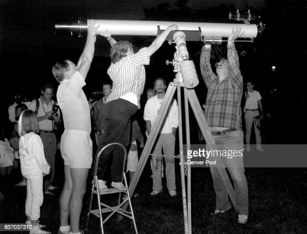 Cathie Havens in the middle Jim Moravec right with the help of a unidentified man who helped them put up a 6 inch custom built refactor telescope to...