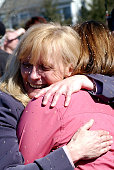 Cathie Knierim mother of Jennifer Smits embraces her new daughterinlaw Dana Wegener of New Paltz New York after Smits and Wegener wed in a...