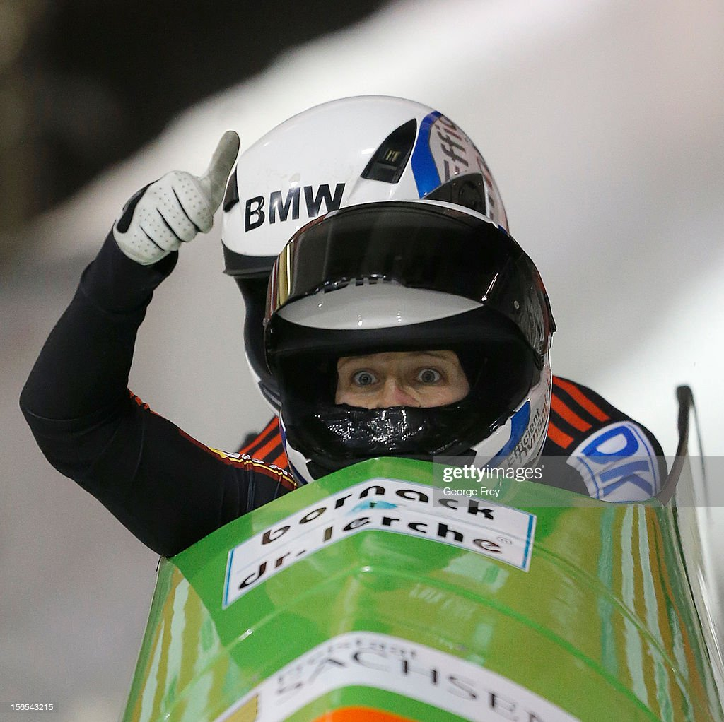 Cathleen Martini (F) and Stephanie Schneider of Germany celebrate a third place finish in the FIBT women's bobsled world cup, on November 16, 2012 at Utah Olympic Park in Park City, Utah.