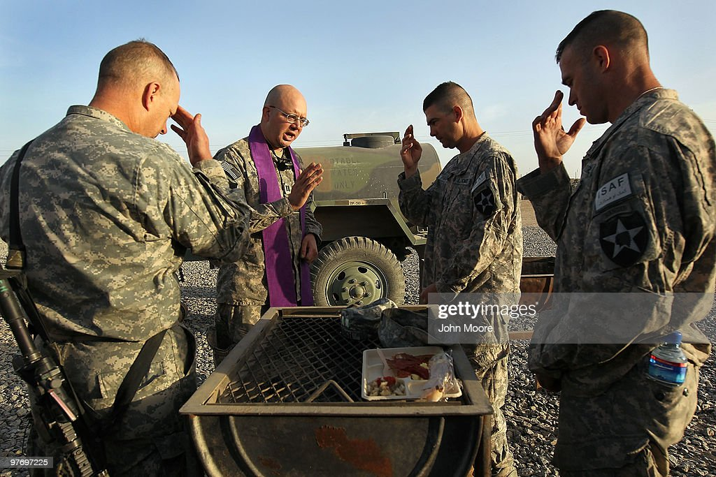 Catholic Chaplain Cpt. Carl Subler (2L) blesses U.S. Army commanders before a military operation on March 14, 2010 at Howz-e-Madad in Kandahar province, Afghanistan. He celebrated communion with officers before accompanying soldiers from the 2nd Battalion, 1st Infantry Regiment on an offensive operation against Taliban in the area. Although U.S. military chaplains are non-combatants, Subler goes on combat patrols to provide support for troops in the field. Military chaplains travel the battlefield throughout Afghanistan, providing a backbone of support for thousands of soldiers struggling with the difficulties of war and year-long deployments away from home.