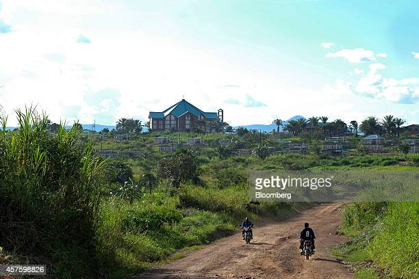 A Catholic church built with funds from Randgold Resources Ltd and AngloGold Ashanti Ltd stands near new local housing built near the Kibali gold...