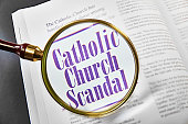 Catholic Church Scandal on magazine with magnifying glass+++ I wrote all the text +++