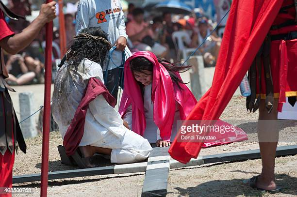 Catholic devotee during the reenactment of the crucifixion of Christ on Good Friday on April 3 2015 in San Pedro Cutud village in Pampanga province...
