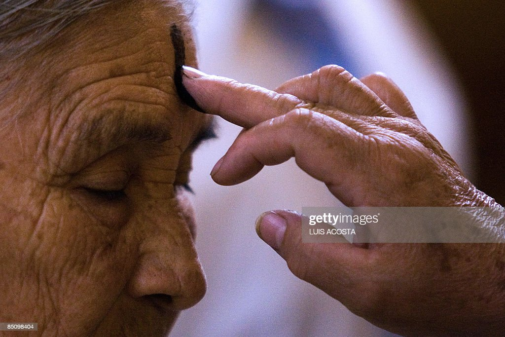 A Catholic devotee gets the mark of the cross of ashes on her forehead, during the celebration of Ash Wednesday, in Mexico City, on February 25, 2009. AFP PHOTO/Luis Acosta
