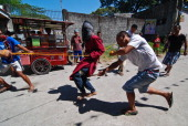 Catholic devotee is whipped by bystanders using vulcanized rubber as a form of penance during holy week on March 28 2013 in Pampanga Philippines The...
