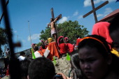 Catholic devotees are nailed to crosses during a reenacment of the crucifixion of Christ on Good Friday on April 18 2014 in Pampanga province...