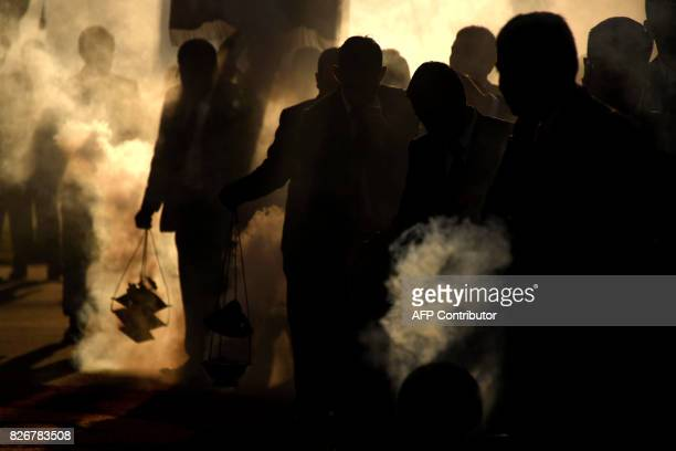 Catholic devotees burn incense during the Jesus de La Merced procession during the celebration of the 300 years of the consecration in Guatemala City...