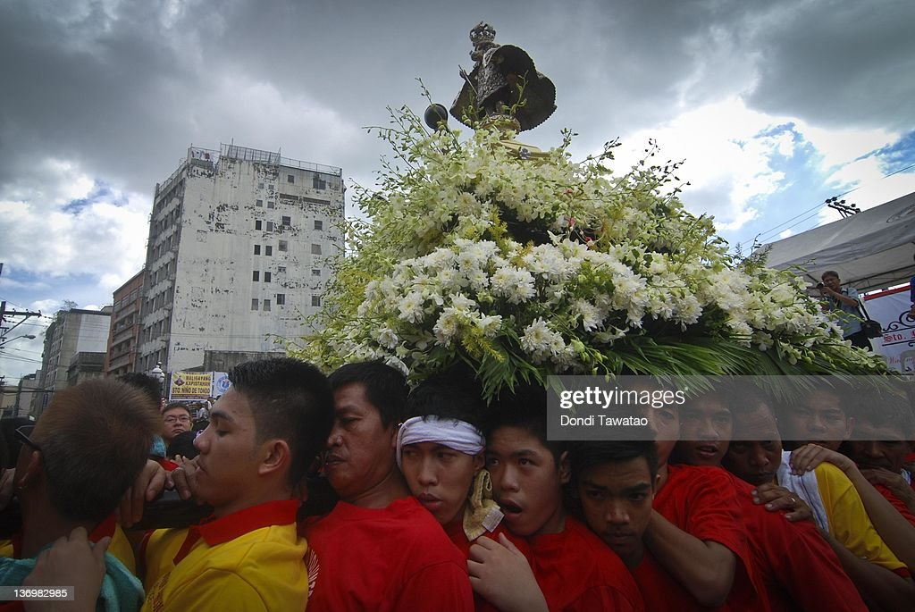 Catholic devotees carry a religious image of the Child Jesus to celebrate the grand procession of the feast of Santo Nino dubbed 'Lakbayaw' from the Tagalog words, 'Lakbay' (travel) and 'Sayaw' (dance) in the urban area of Tondo on January 14, 2012 in Manila, Philippines. The devotion to the Sto Nino is celebrated every year in colorful, festive processions and marks the start of revelry in various parts of the Philippines. The Philippines is the only Roman Catholic nation in Southeast Asia with around 93 percent practicing the faith.
