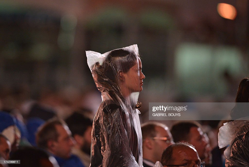A Catholic faithful attends the World Youth Day (WYD) opening mass, at Copacabana beach in Rio de Janeiro, Brazil, on July 23, 2013. The highlight of the landmark visit of Pope Francis to the world's most populous mainly Catholic country will be WYD, a five-day event that kicks off today. Pope Francis's popularity on his Latin American home turf posed a challenge to Brazilian authorities Tuesday after adoring crowds mobbed his car on his arrival on Monday.