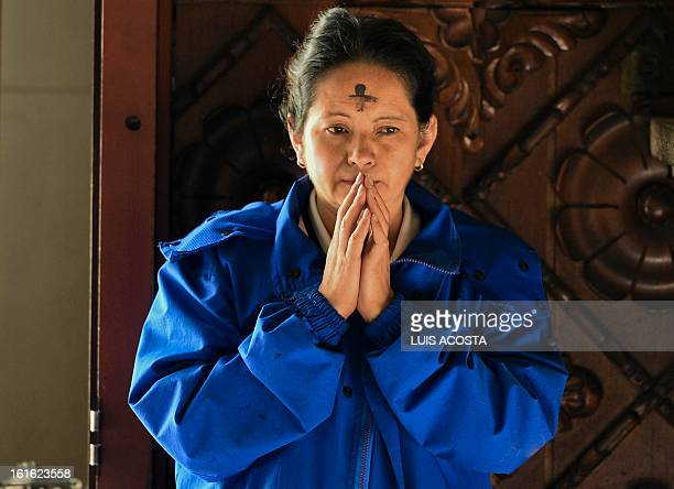 A Catholic faithful has her forehead marked with a cross of ash during the celebration of Ash Wednesday in Bogota on February 13 2013 Ash Wednesday...