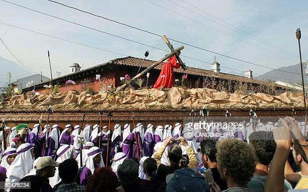 Catholic faithful participate in the procession of Jesus de Nazareno de La Merced 25 March 2005 in Antigua Guatemala 45km west from Guatemala City...