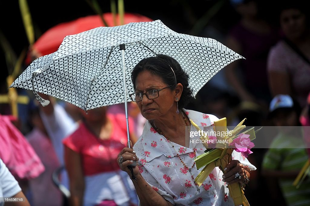 A Catholic faithful participates in a Palm Sunday procession in Managua, on March 24, 2013. Palm Sunday marks the beginning of Holy Week, and commemorates Christ's triumphant entry into Jerusalem on the back of a donkey, welcomed by crowds waving palm branches, before his arrest, trial, crucifixion and resurrection. It is traditionally marked by a procession and special mass. AFP PHOTO/Hector RETAMAL