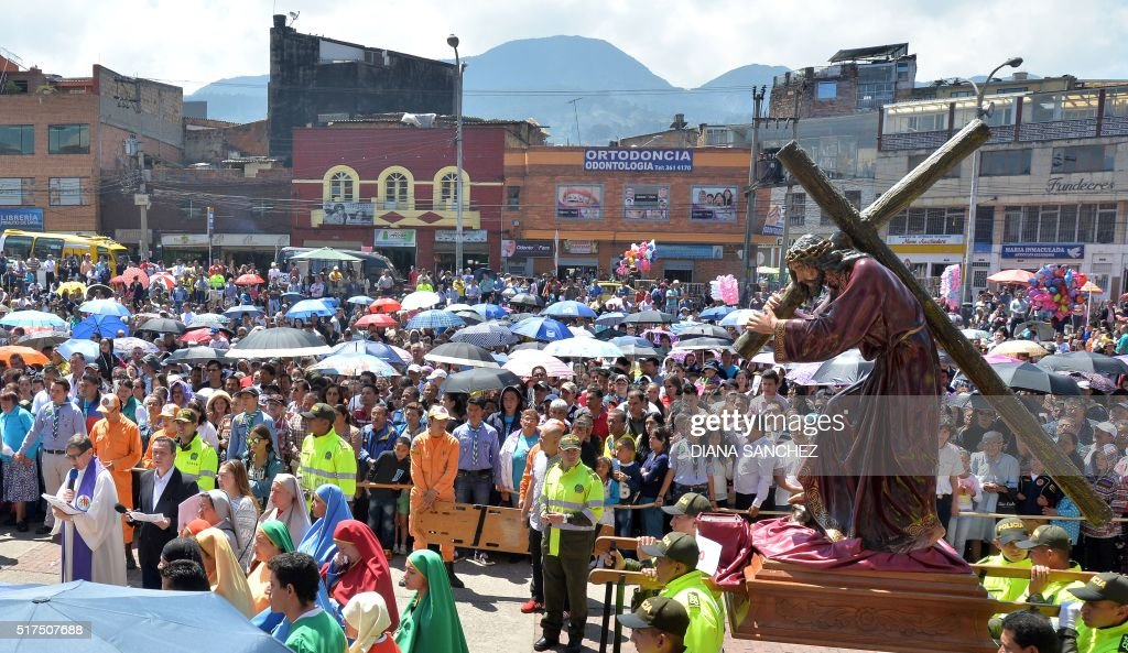 Catholic faithful take part in a Via Crucis procession as part of the Good Friday ceremonies in the '20 de Julio' neighborhood in Bogota, Colombia, on March 25, 2016. Christian believers around the world mark the Holy Week of Easter in celebration of the crucifixion and resurrection of Jesus Christ.