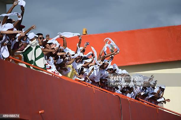 Catholic faithful wait for the arrival of Pope Francis in Santiago de Cuba on September 21 2015 Santiago the last stop on Pope Francis's Cuban tour...