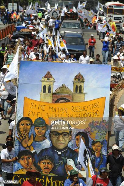 Catholic faithfuls and members of social organizations take part in a march marking the 28th anniversary of the assasination of archbishop Oscar...